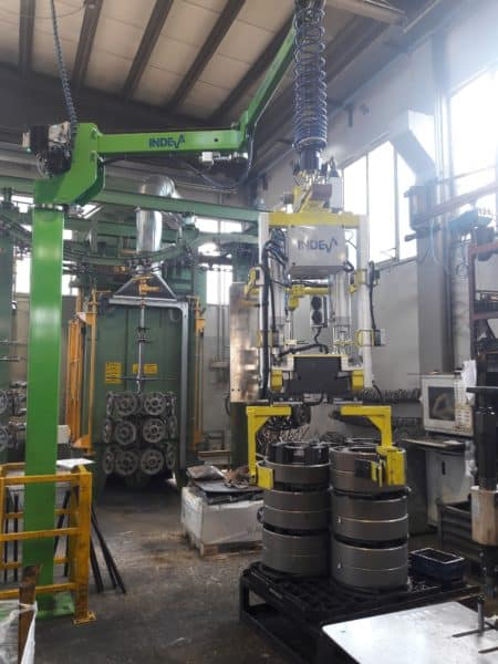 picture showing the application of an industrial manipulator with custom end effector for handling spur gears